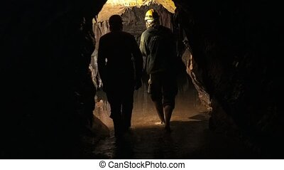 Underground cave with light coming through - Dark...