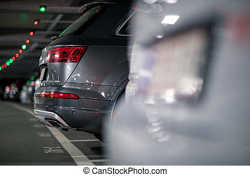 Underground garage or modern car parking with lots of vehicles, perspective