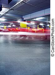 Underground parking garage with moving car