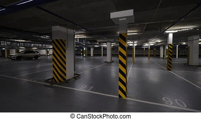 Underground parking with few cars - Rotating shot of almost...