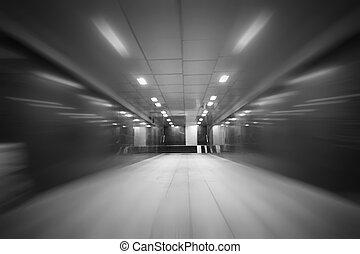 underground passage with lights blur background