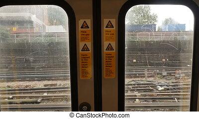 Underground train sliding doors from inside in moving train. 4k