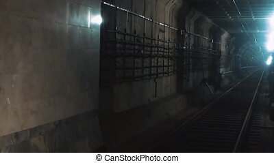Underground tunnel for the subway leading deep down. he...