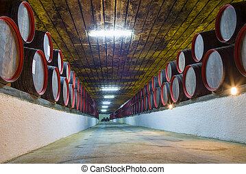 Underground wine wooden barrels stack