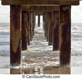 Ocean fishing pier underneath