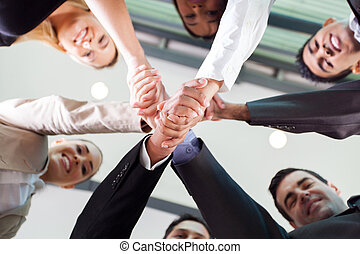 underneath view of businesspeople handshaking - underneath...