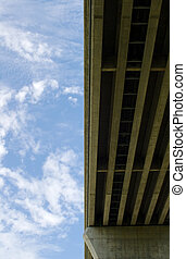 Underside of bridge on sky