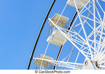 Underside view of a ferris wheel rotating downward