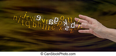 Understanding Dyslexia - Female hand with the alphabet...
