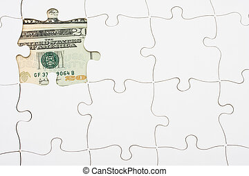 Understanding finances - Puzzle with money under it....