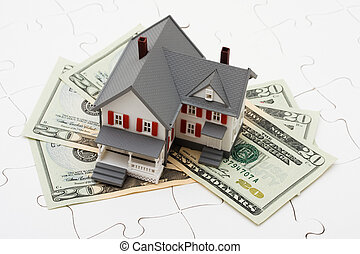Understanding Mortgages - House sitting on money with...