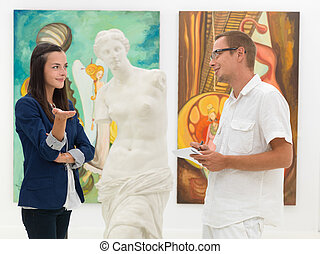 understanding the artwork - two young caucasian people...
