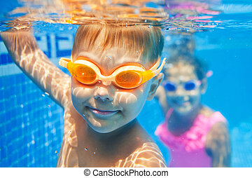 Underwater boy - Close-up underwater portrait of the cute...