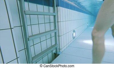 Underwater boy in aquapark