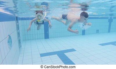 Underwater children in aquapark - Happy little girl and boy...