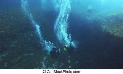 Underwater drift through the air bubbles.