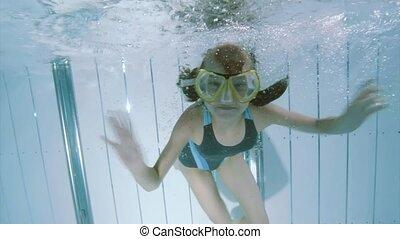 Underwater girl in aquapark