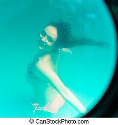 underwater girl in swimming pool