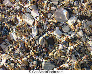 Underwater pebble texture - Colorful stones under sea water,...