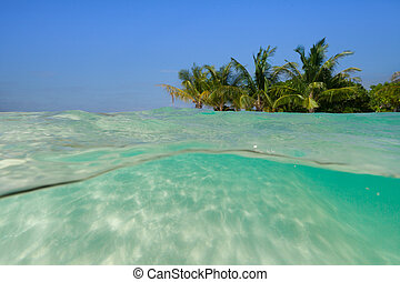 Underwater sandy beach with tropical island
