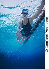 Underwater shoot of a professional sportsman swimming in crawl style