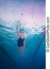 swimming in crawl style - Underwater shoot of a professional...