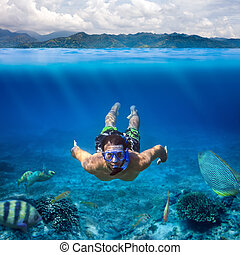 Underwater shoot of a young man snorkeling in a tropical sea on vacation
