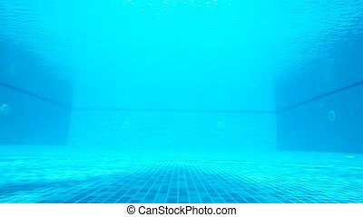Underwater shot of hotel swimming pool on a sunny day