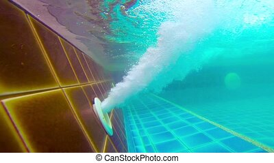 Underwater Shot of Pool Jet Blowing Bubbles