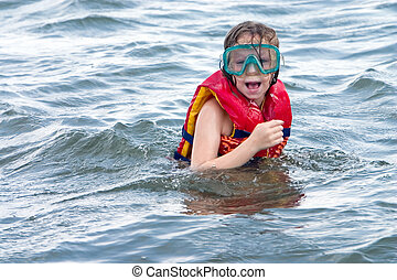 Young girl with swim goggles suprised by what she saw