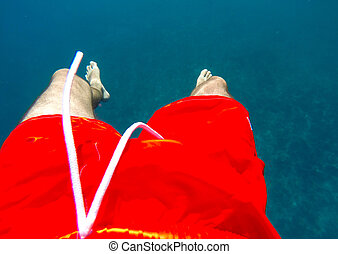 Underwater swimming in red swimwear