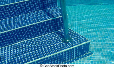 Underwater swimming pool staircase.