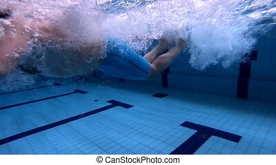 underwater view male freestyle swimmer in pool