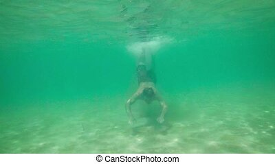 Underwater View of a Tourist, Swimming in the Tropical Sea