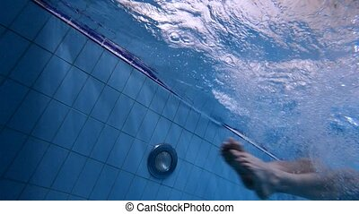 underwater view of swimmer starts from the side of the pool
