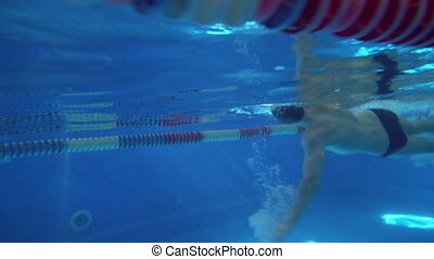 Underwater view to the beautiful professional swimmer...