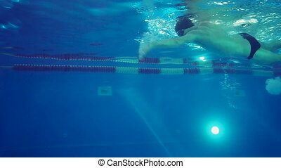Underwater view to the professional swimmer swiming crawl...