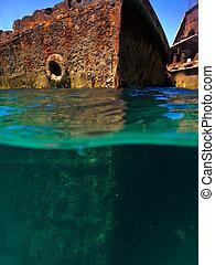 Rusty hulls of shipwrecks at Moreton Island viewed from waterline