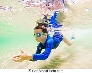 Underwater Young Boy Fun in the sea with Goggles. Summer Vacation Fun.