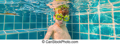 Underwater Young Boy Fun in the Swimming Pool with Goggles. Summer Vacation Fun BANNER, LONG FORMAT