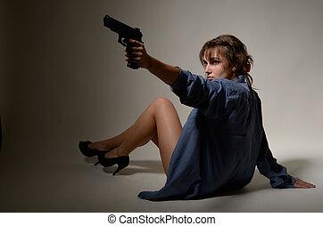 Undressed girl with a handgun