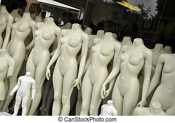 Undressed Puppets - Naked Mannequin before a shop window