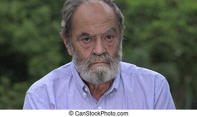 Unemotional Bearded Hispanic Senior Old Man