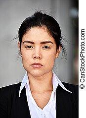 Unemotional Hispanic Business Woman