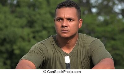 Unemotional Hispanic Male Soldier