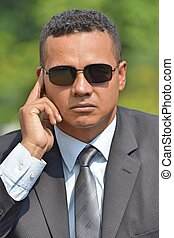 Unemotional Security Guard Spy Wearing Sunglasses