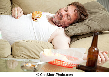 Unemployed and Unhealthy - Scruffy unemployed man passed out...