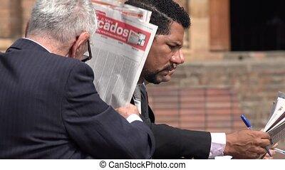 Unemployed Business Men Reading Newspaper