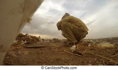 unemployed dump homeless dirty looking man food waste in a landfill social  video