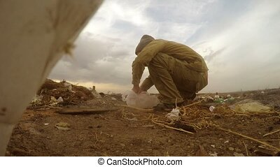 unemployed dump homeless dirty man looking food waste in a ...